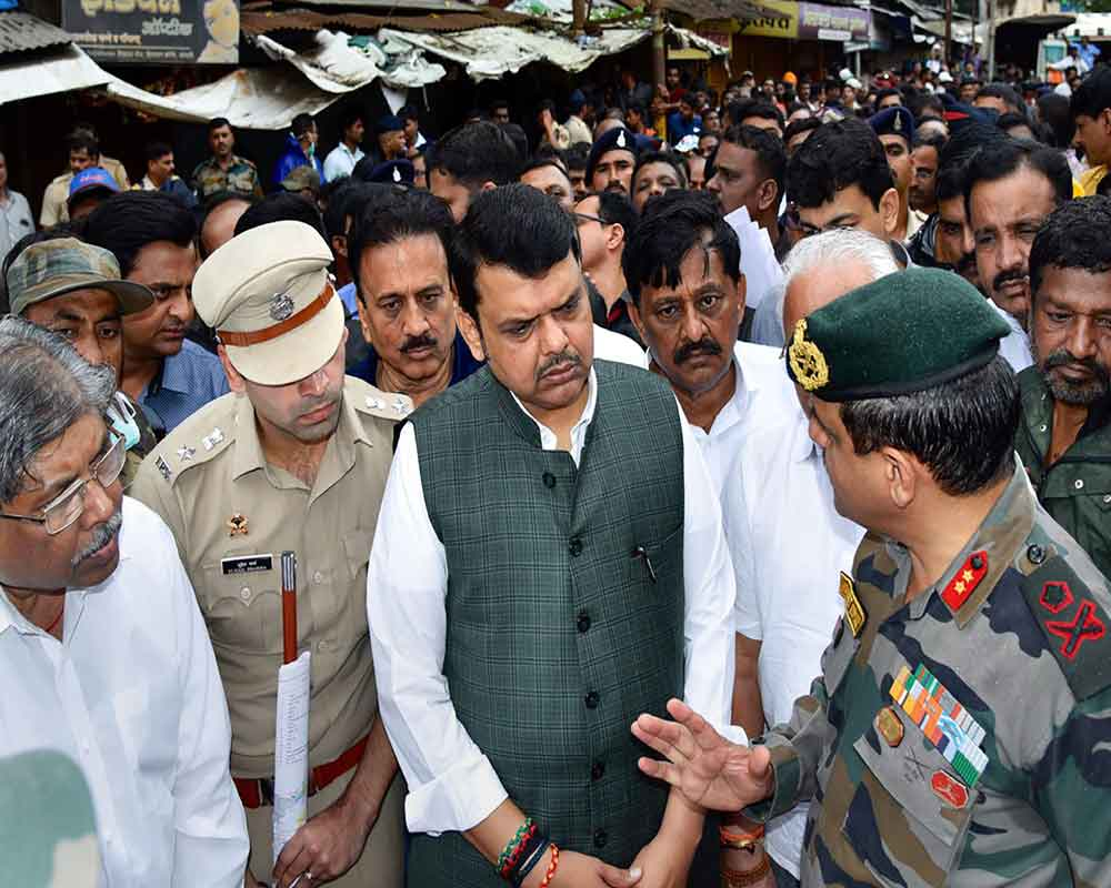 Maharashtra Chief Minister Devendra Fadnavis and State Revenue and PWD Minister Chandrakant Patil visit flood affected areas in Sangli - PTI