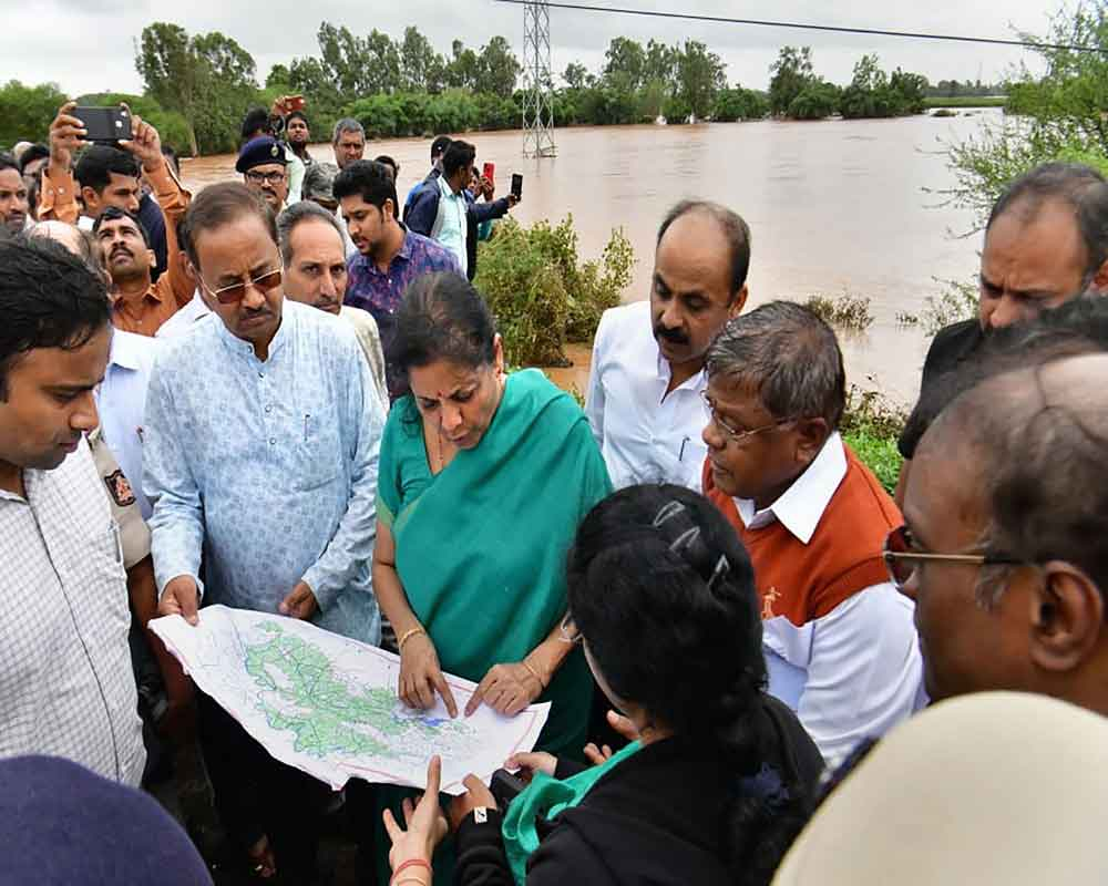 Finance Minister Nirmala Sitharaman inspects flood affected areas in Belgaum district - PTI