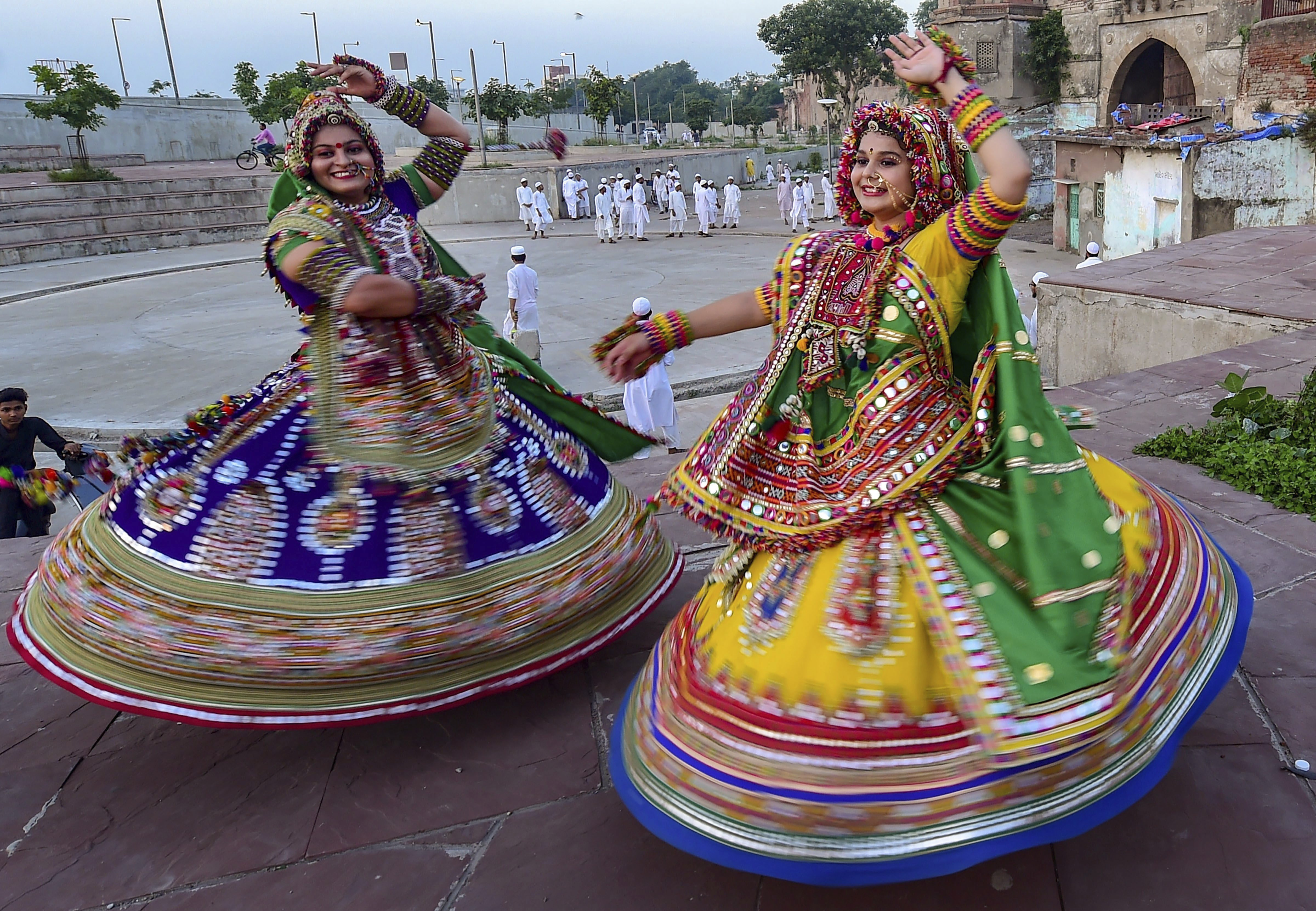 Dancers, dressed in traditional attire, take part in the rehearsals for the 'Garba' dance, ahead of nine-day Navratri festival in Ahmedabad - AP