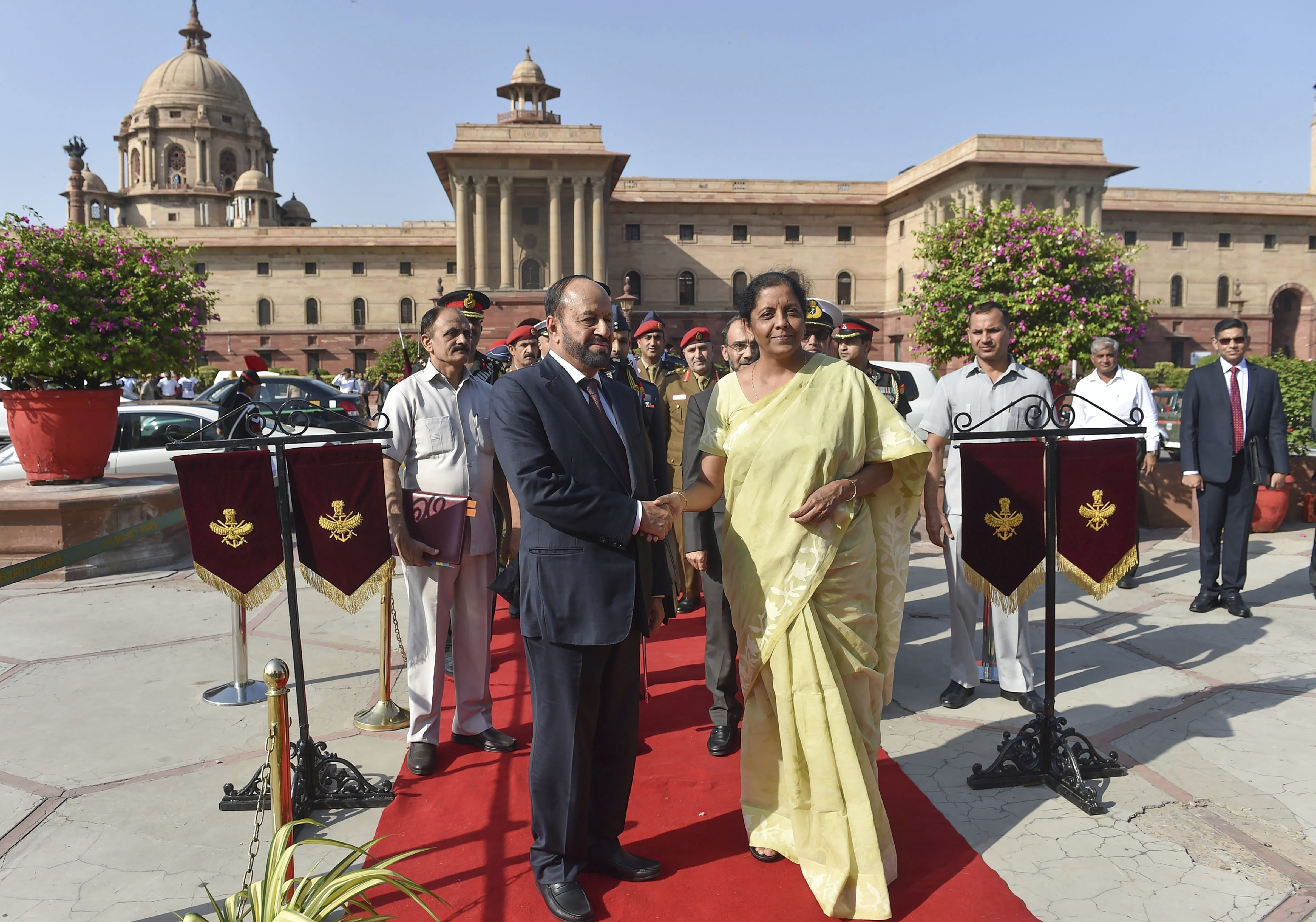 Defence Minister Nirmala Sitharaman shakes hands with Oman's Defence Minister Badr bin Saud al-Busaidi prior to a meeting at South Block in New Delhi - PTI