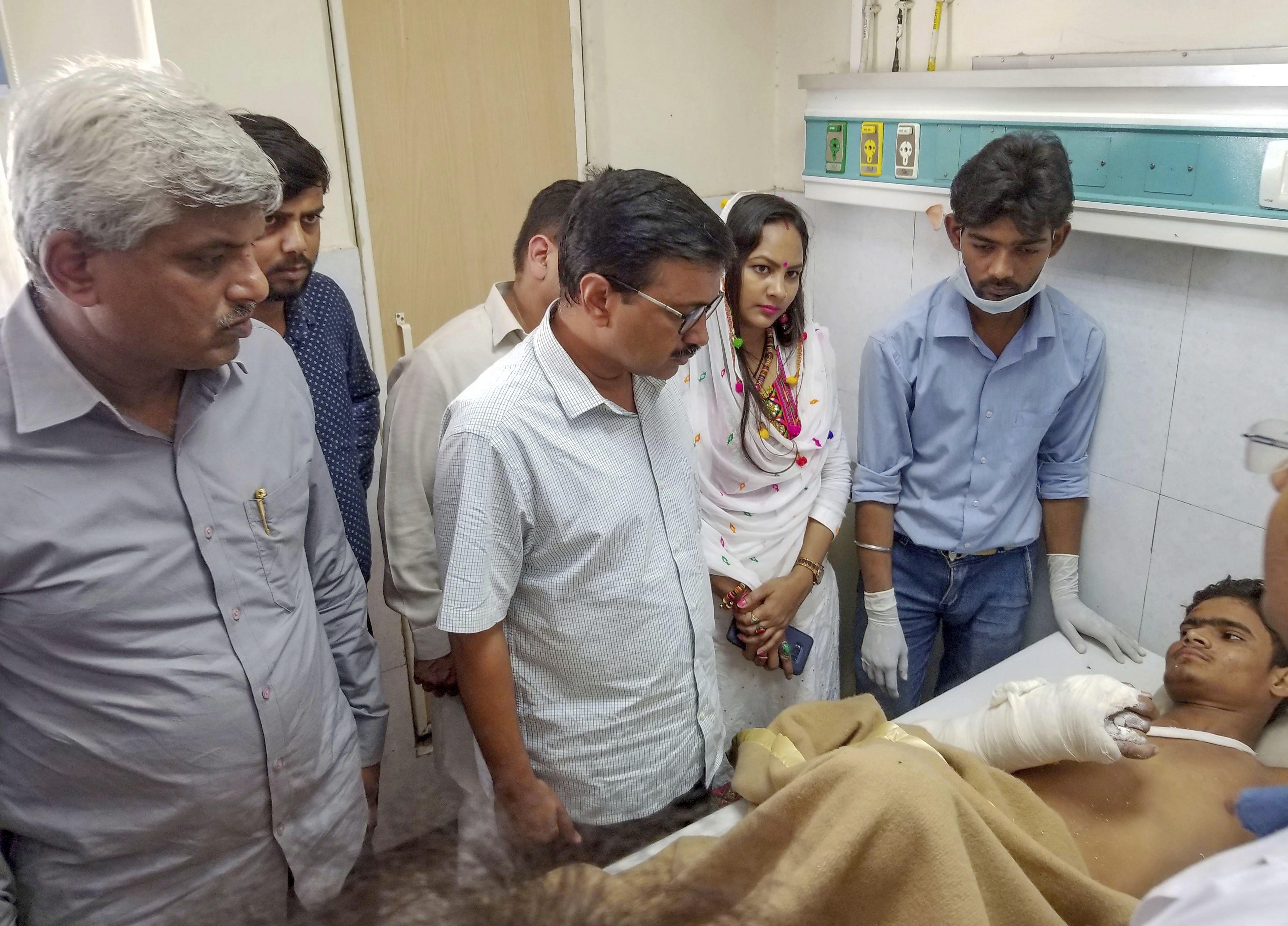 Delhi Chief Minister Arvind Kejriwal visits a victim of a building collapse in Ashok Vihar, at a hospital in New Delhi - PTI