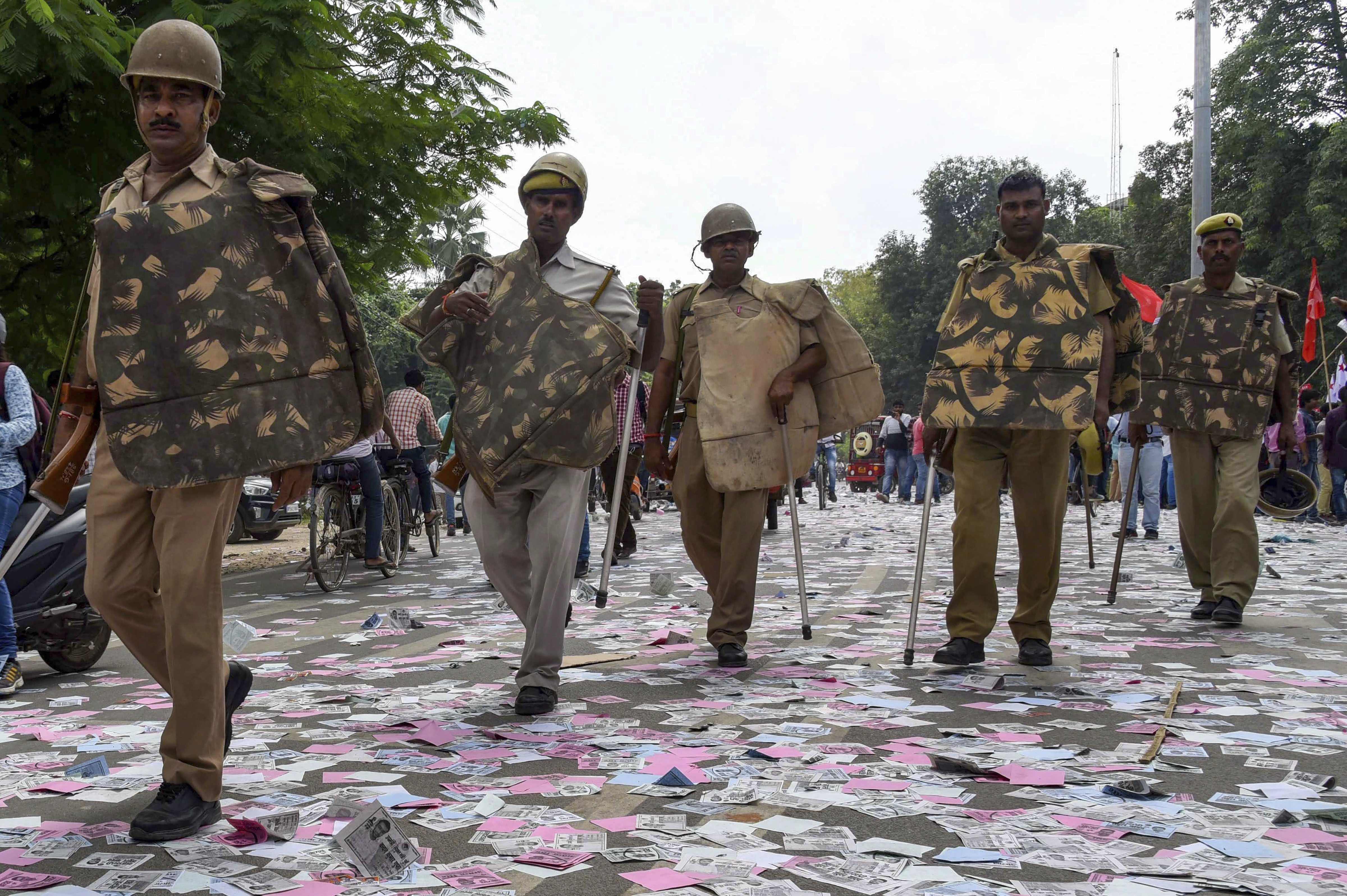 Police arrive to control the situation after a clash between two students' groups during nomination filing for Allahabad University Students elections, in Allahabad - PTI