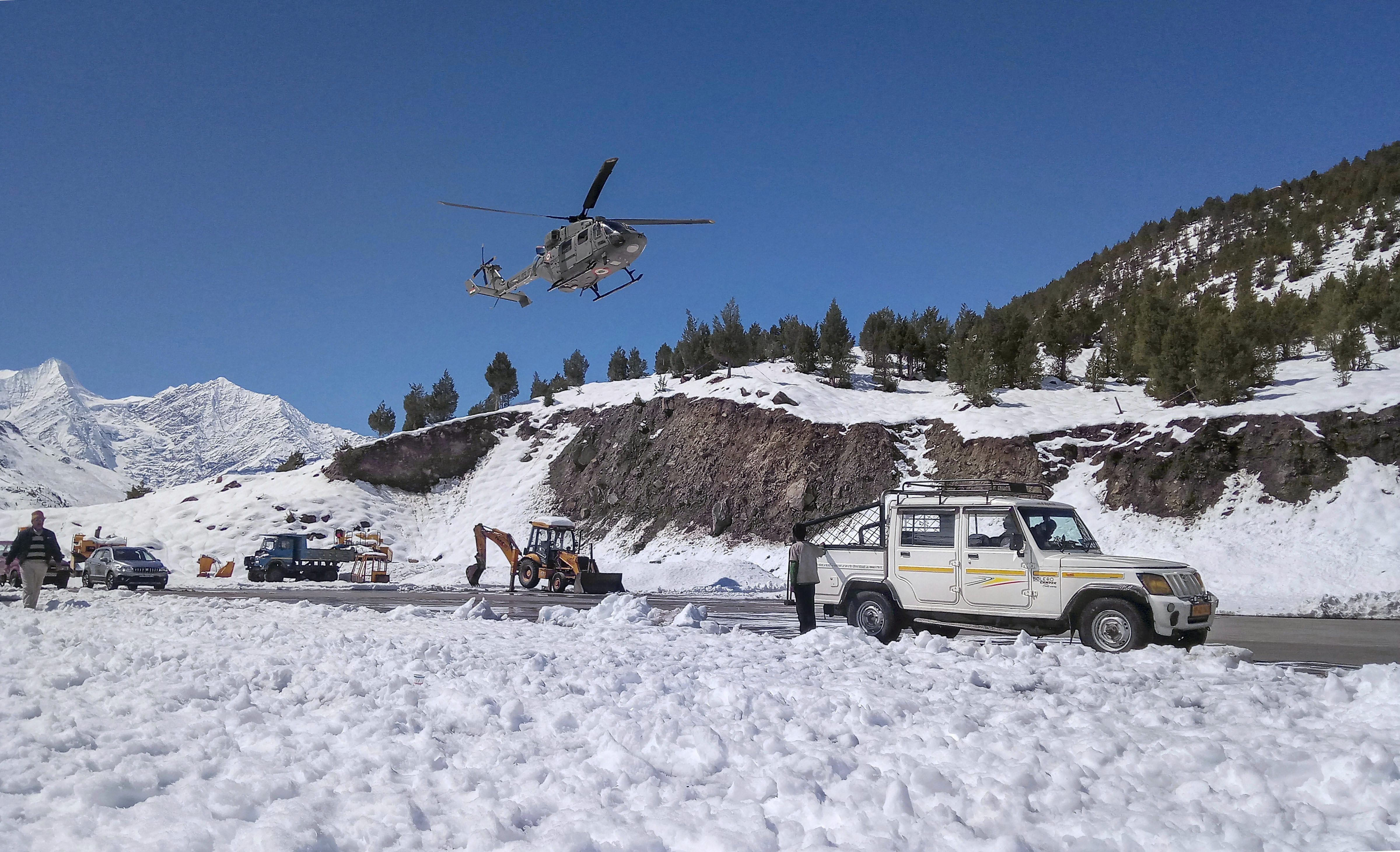 Indian Air Force (IAF) carry out rescue operations at a remote shelter as incessant rains continue to disrupt daily lives, near Chhota Dara - PTI
