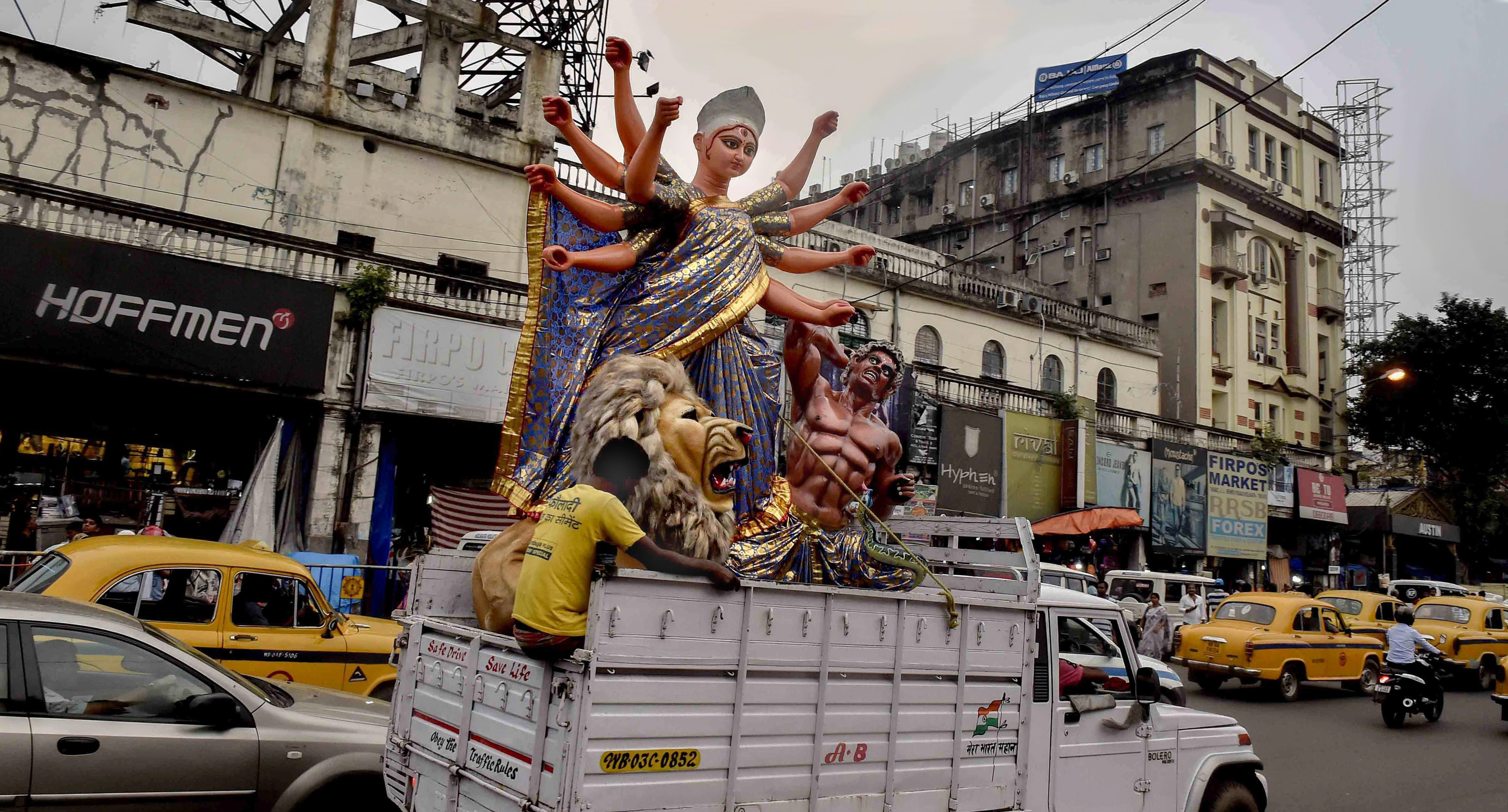 An idol of Goddess Durga is taken to a pandal for the installation ahead of Durga Puja festival in Kolkata - AP