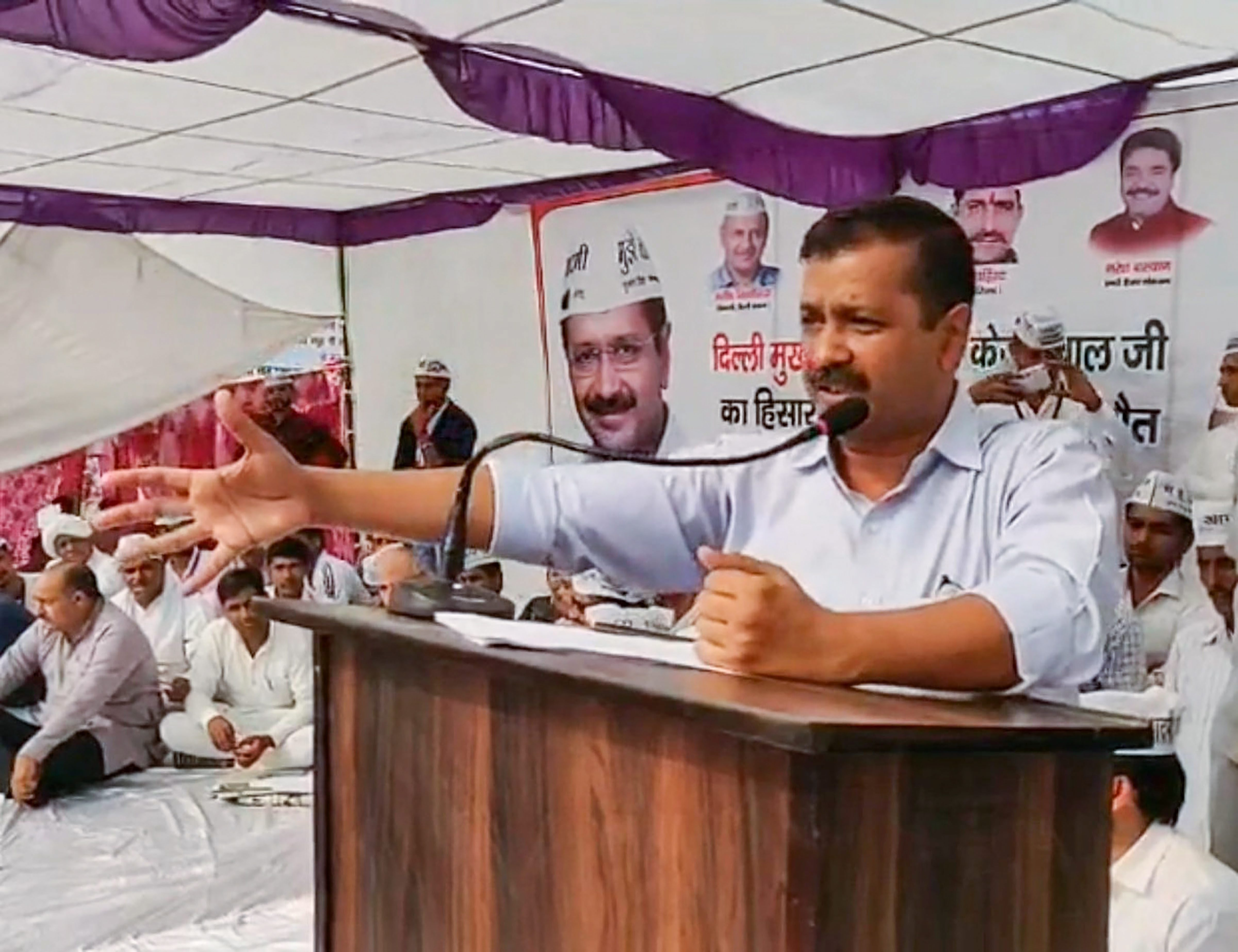Delhi Chief Minister Arvind Kejriwal addresses a public meeting in Chanaut village of Hisar district - PTI