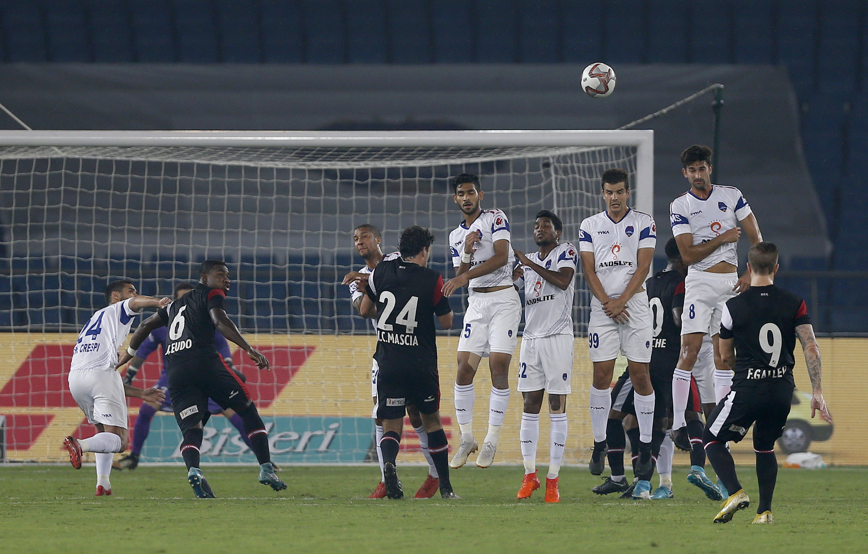 Delhi Dynamos FC players leap in air to stop a the ball hit by NorthEast United FC's Federico Gallego during Hero Indian Super League soccer match between Delhi Dynamos FC and NorthEast United FC in New Delhi - AP