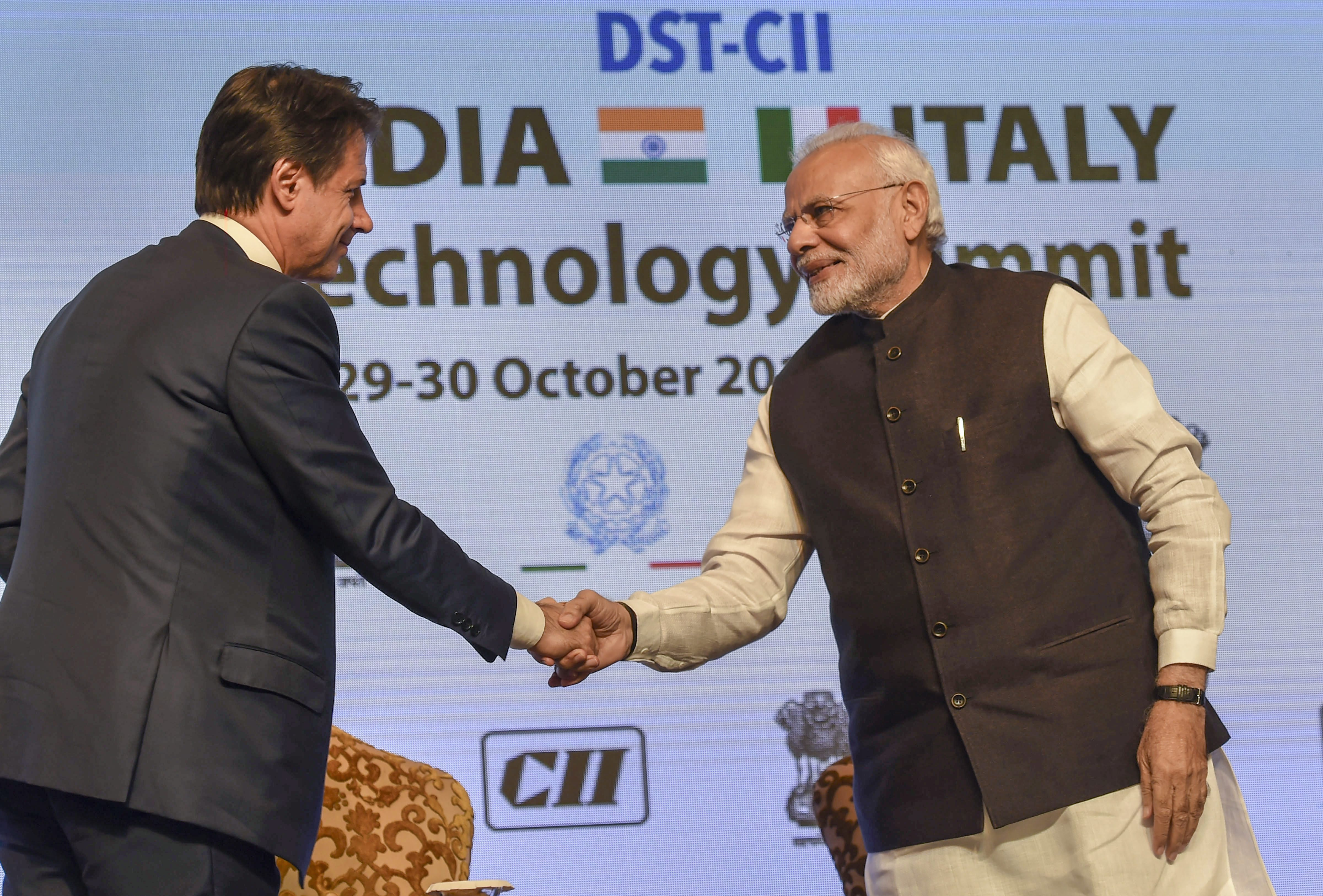 Prime Minister Narendra Modi shakes hands with Italian Prime Minister Giuseppe Conte during the India-Italy Technology Summit, in New Delhi - PTI
