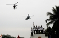 Today's Photo : Indian army buglers perform as helicopters fly past the base