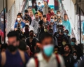 Today's Photo : Passengers wear masks a precautionary measure against the coronavirus