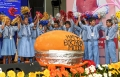 Today's Photo: School children stand behind the 569 kg 'Laddu'  to celebrate PM Narendra Modi's birthday