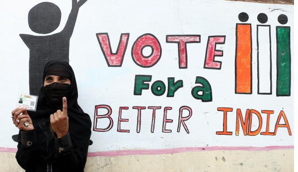 Today's Photo : A woman shows her election identity card during the civic body polls in Pushkar