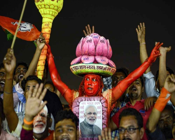 Today's Photo : BJP supporter wears a poster of PM Narendra Modi