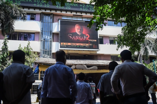Today's Photo : People look at the screen on BSE building as the sensex soars on the vote counting day for the 2019 Lok Sabha polls