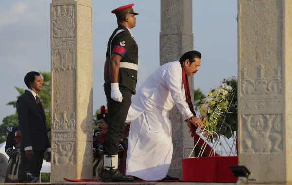 Today's Photo : Sri Lanka's Former president places a wreath at the fallen heroes memorial