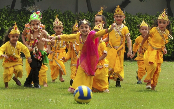 Today's Photo: Children dressed up as Lord Krishna play football during 'Janmashtami' celebrations