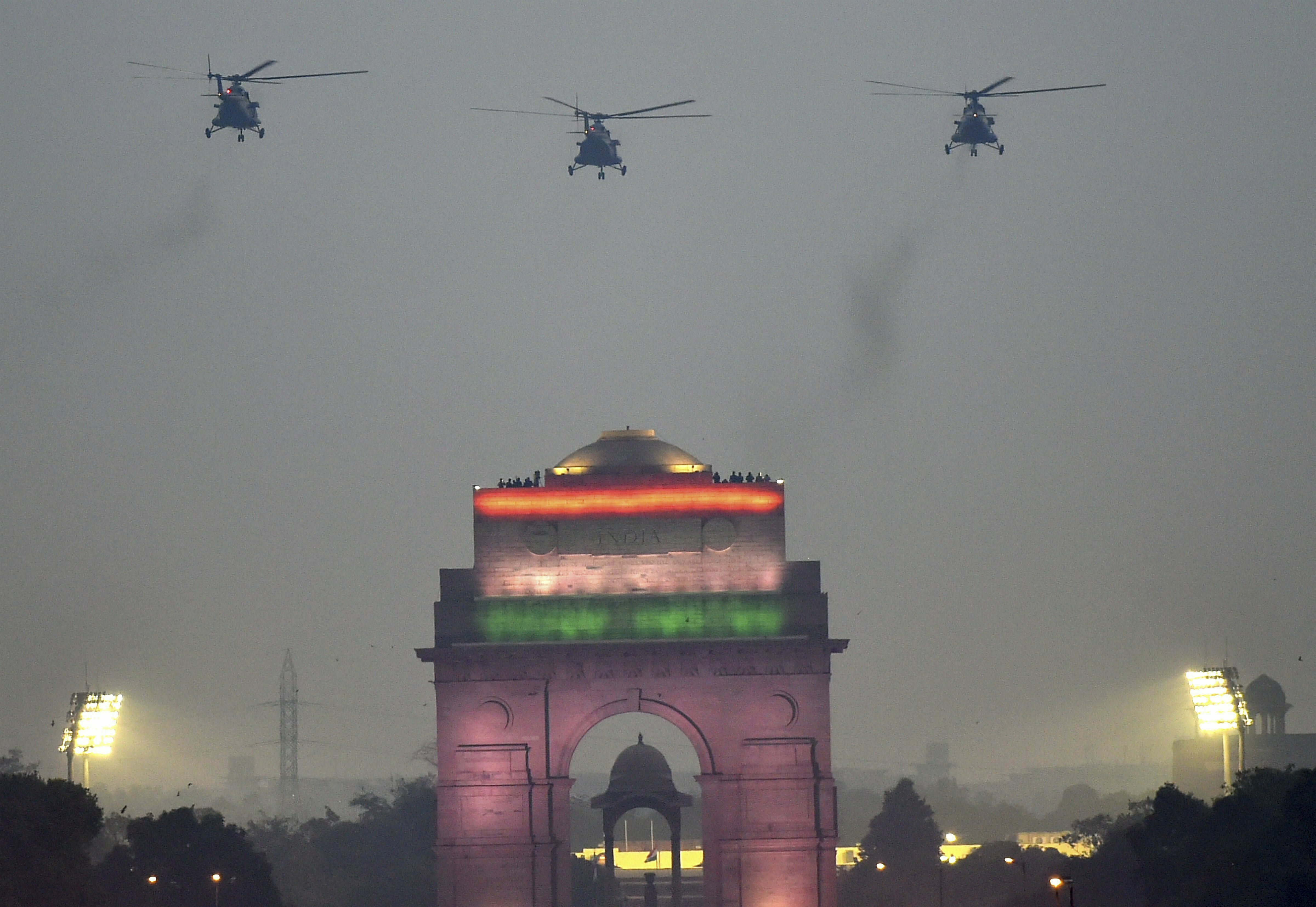 IAF choppers fly-past to shower flower petals on the National War Memorial (NWM) during its inauguration ceremony at India Gate complex in New Delhi - PTI