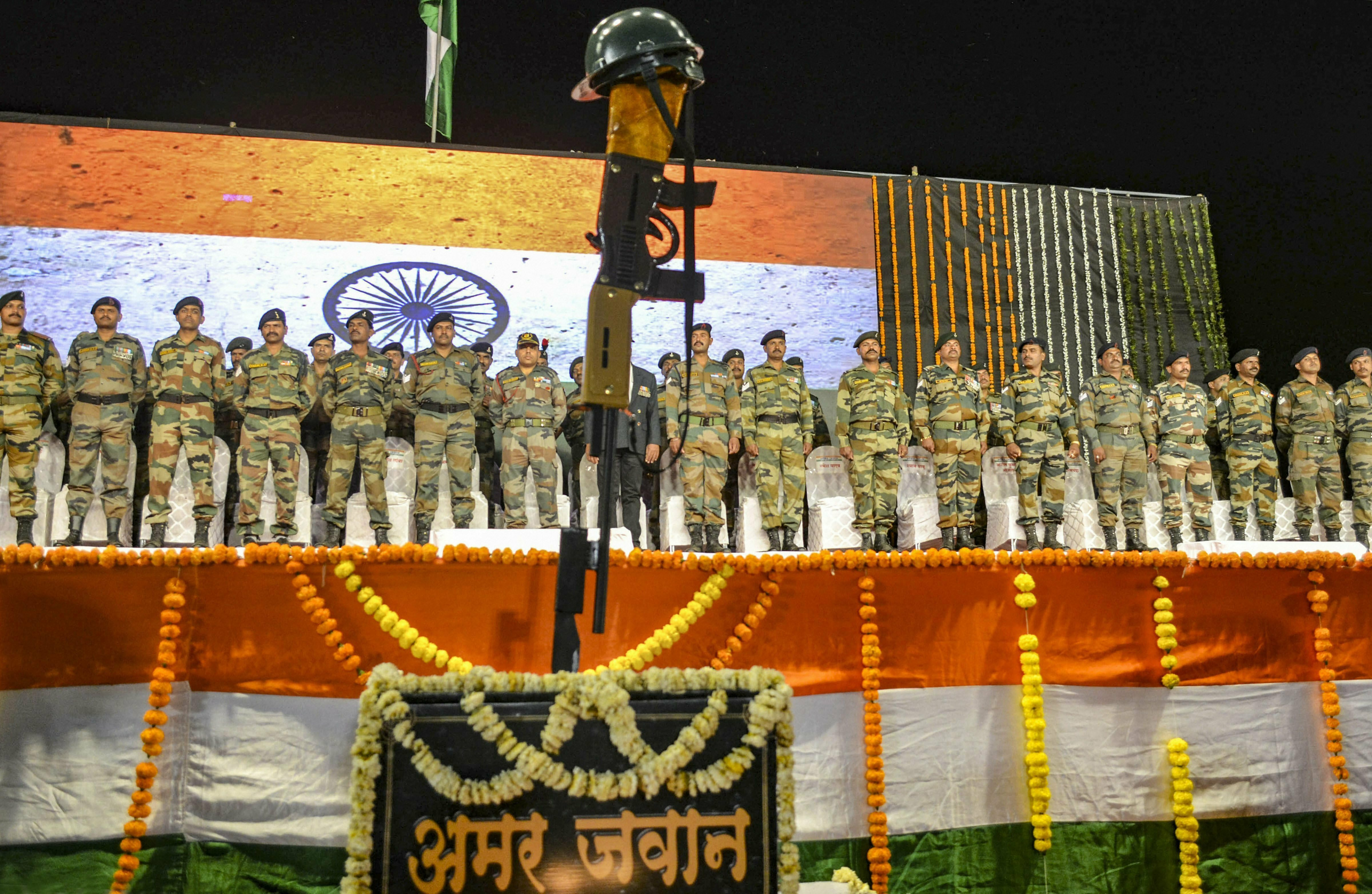Army personnel pay tribute to the martyrs of Pulwama terror attack, in Karad - PTI