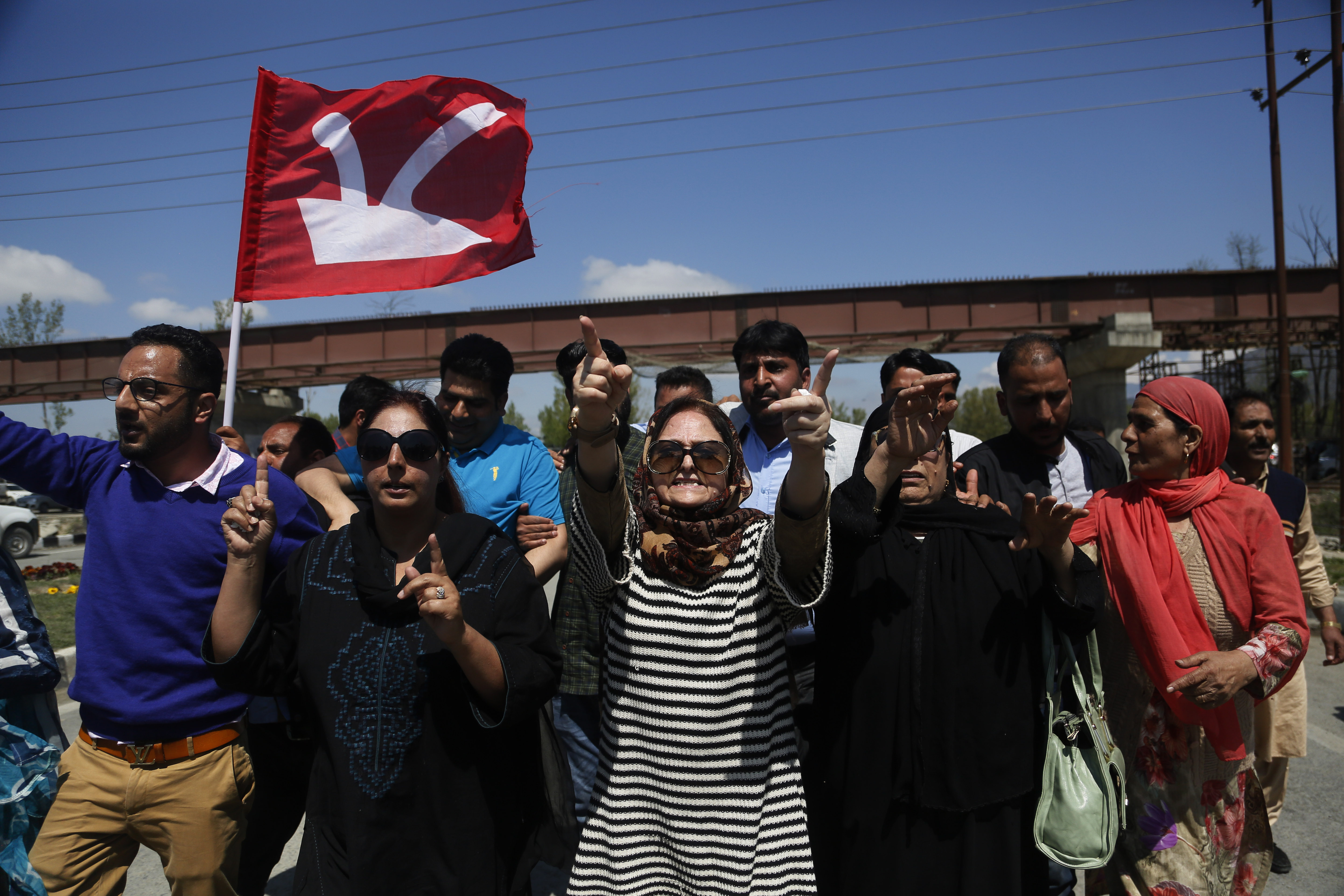 Supporters of former Jammu and Kashmir chief minister and National Conference (NC) leader Omar Abdullah shout slogans during a protest against a twice-weekly ban on the movement of civilian vehicles on a key highway on the outskirts of Srinagar - AP