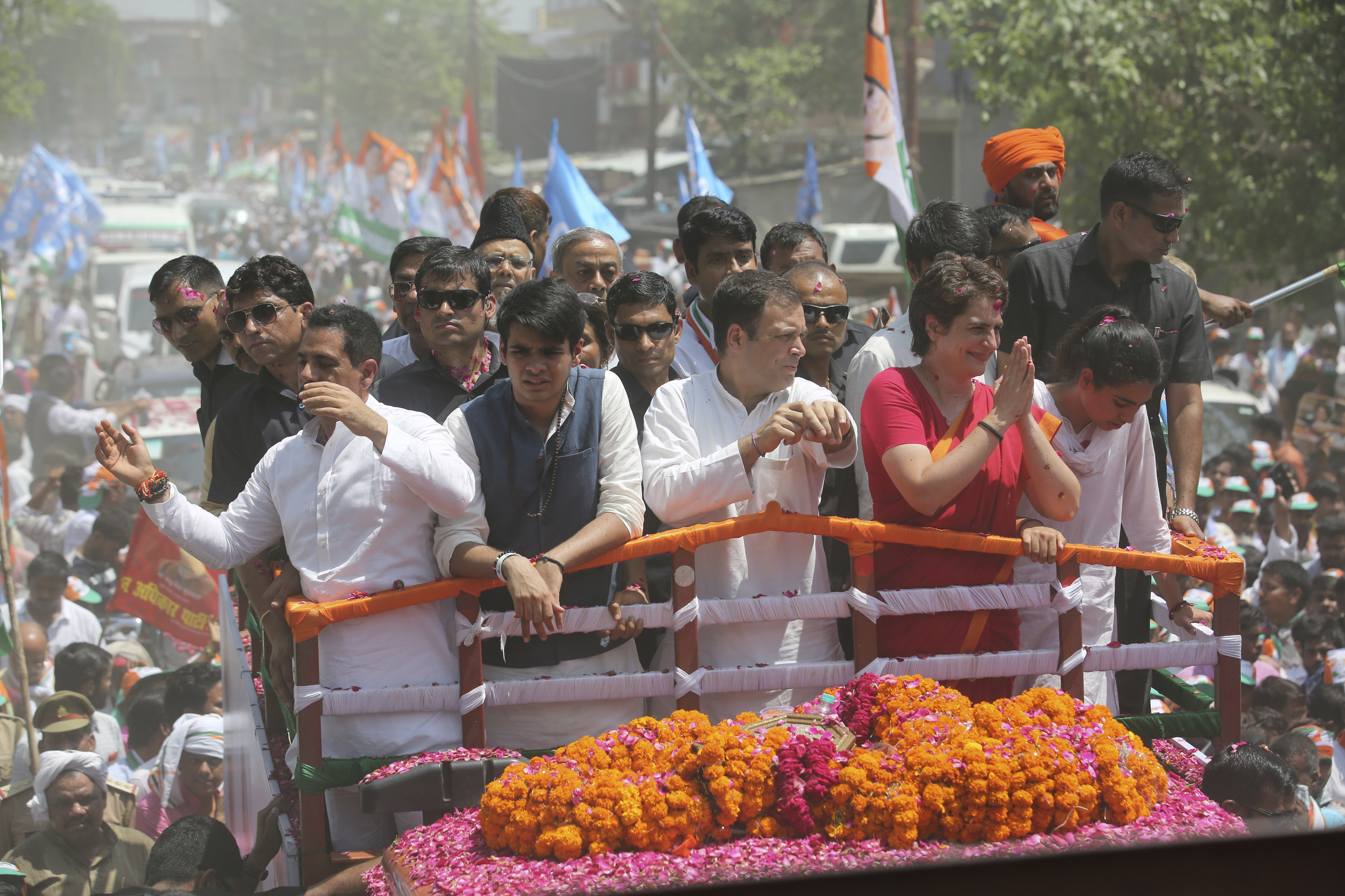 Congress party chief Rahul Gandhi, center in white, accompanied by his sister Priyanka Vadra in red arrives to file his nomination papers for the upcoming general elections in Amethi, Uttar Pradesh - AP
